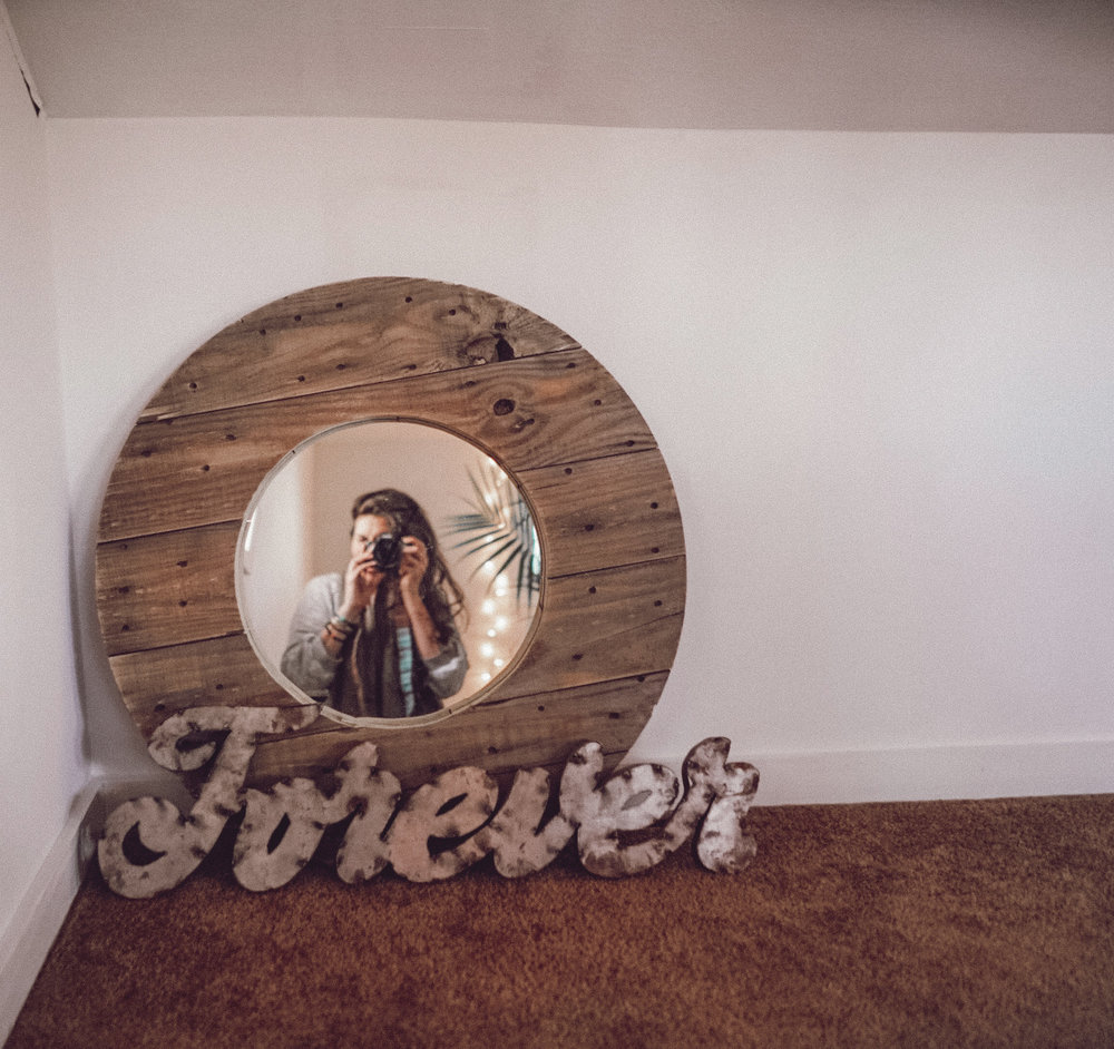 I make 98.9% of our decor, including this mirror. Comment below if you'd like to see more of my handcrafted pieces!