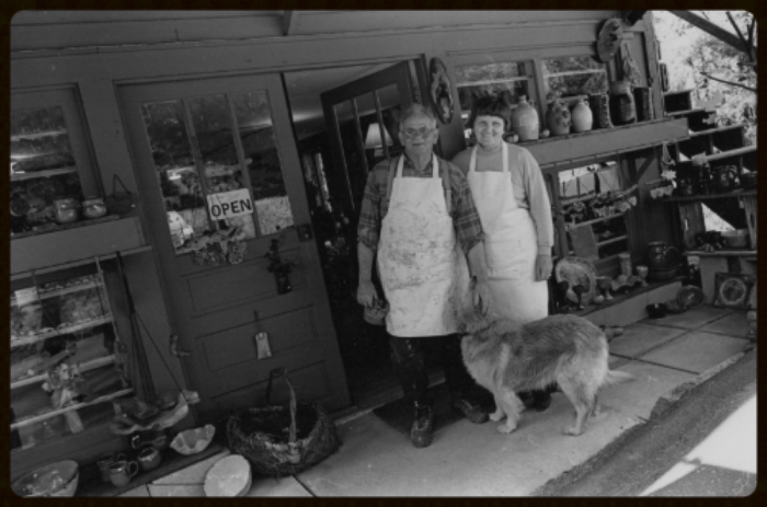 "John and Sybil Dodson with ""Stinker"" in front of the original shop in the mid 90's. Photo copyright by Rob Amber 2016"