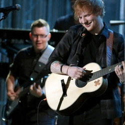 jake morelli performing with ed sheeran