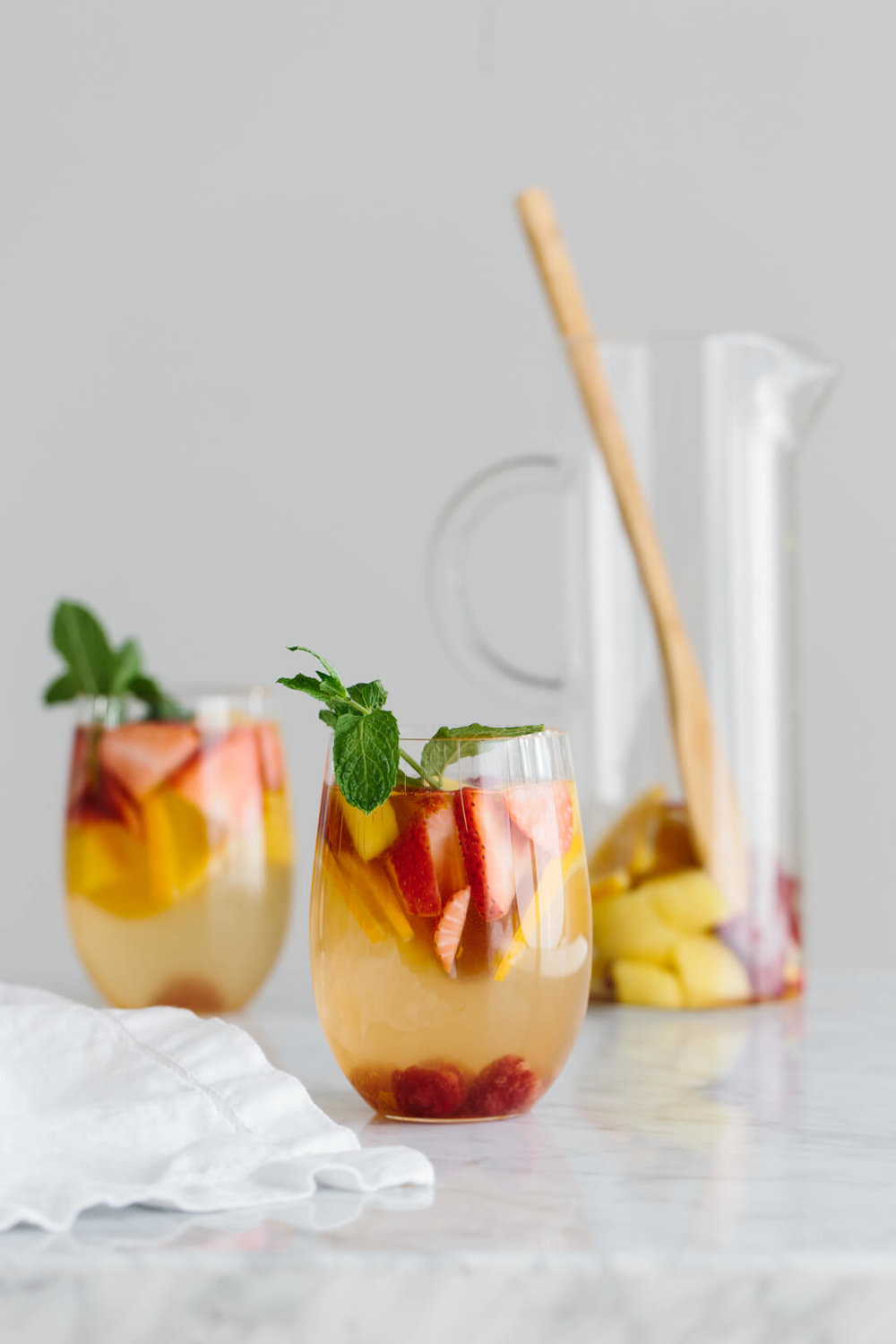 WHITE SANGRIA WITH MANGO AND BERRIES