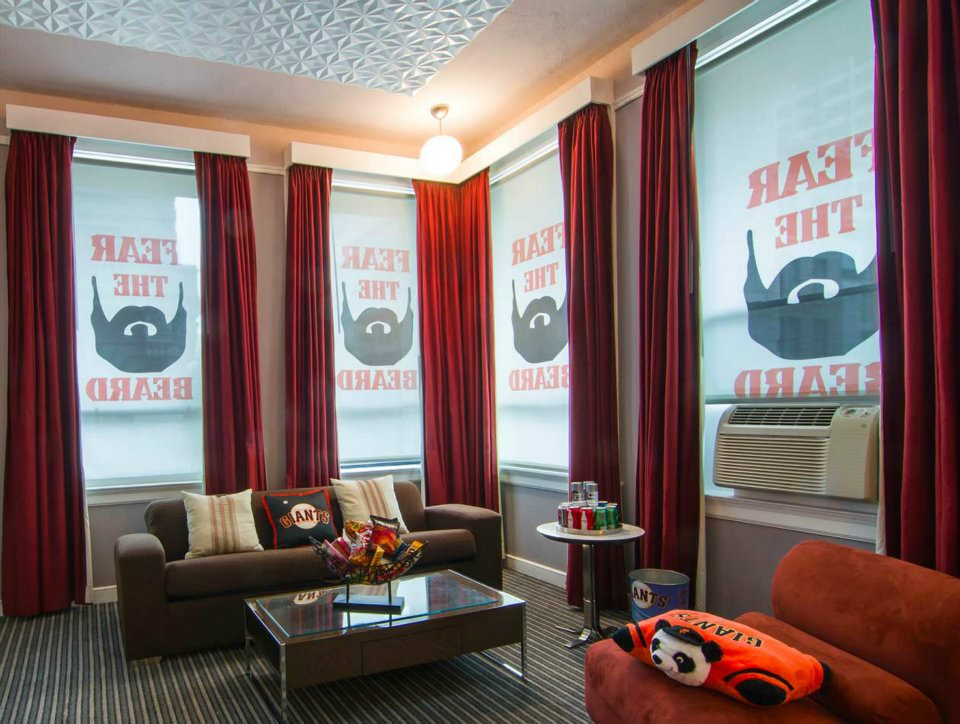 """Custom printed roller blinds at Hotel Union Square in San Francisco. """"Fear the Beard"""" during San Francisco Giants playoff run. Roller blinds were changed out seasonally with OrangePiel."""