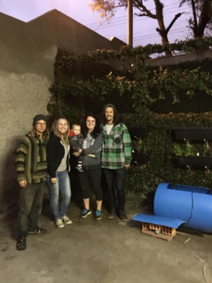 Connor & Adelyne with Becky & Tim after installing the aquaponics system.