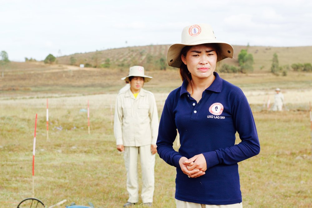 This is a photo I took during a demonstration UXO Lao did for us in the Xieng Khouang Province. All the land behind them is ridden with 40 year old, active, cluster bombs. This all women team goes out and detonates bombs every day.