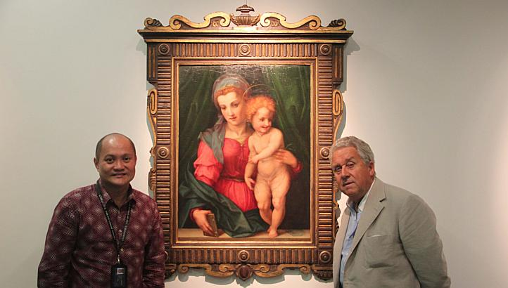 "Chng Hock Huat and Derek Johns in front of ""Holy Family"" by Andrea del Sarto"