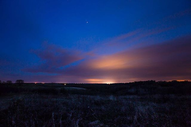 This slip of partially restored tall grass prairie is in one of the darkest corners of the state and still the sky on this early May night is part lapis and part copper, the blue of the cosmos upon which is pinned the hammered sheen of sodium vapor lights. * * *#landscapephotography #longexposure #longexposure_shots #longexposureoftheday #noicemag #nowness #nightphotography #nightscape #nightskies #nightsky #prairie #iowa #bluehour #darksky #InternationalDarkSkies #instagood #instalike #igdaily #ifyouleave