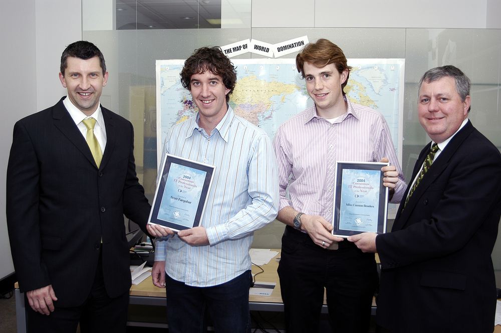 Mike Cannon-Brookes and Scott Farquhar, founders of Atlassian in the early days (Note the map of world domination in the background)