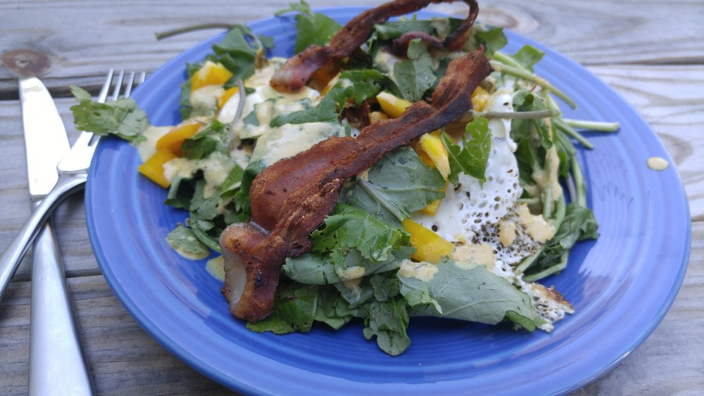 100% local, farmers-market sourced salad with bacon leftover from the weekend, fresh yellow bell pepper, kale, and an egg over-easy. I swear, this isn't difficult!