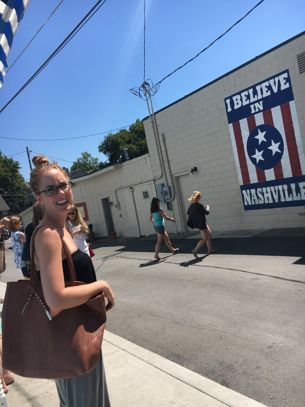 Line to take a photo in front of the I believe In Nashville Mural (Next To Draper James)