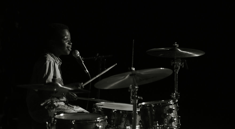 """Brandon Terry has developed a reputation as a gifted young drummer throughout the Pittsburgh area. Only twelve years old, he has already accompanied national jazz saxophonist Jeff Kashiwa as well as received first runner up in the 2012 Western PA Blues Society Competition. Though a versatile performer, Brandon excels within the jazz, funk, fusion, gospel and bebop genres. In addition to the Funky Fly Project, Brandon plays in a number of Pittsburgh groups like the Urban Impact Jazz Ensemble and the Pittsburgh Children's Choir.  """"Funky Fly is about 4 normal boys that play instruments and who enjoy inspiring others through the melodies of jazz and funk."""" -Brandon Terry"""