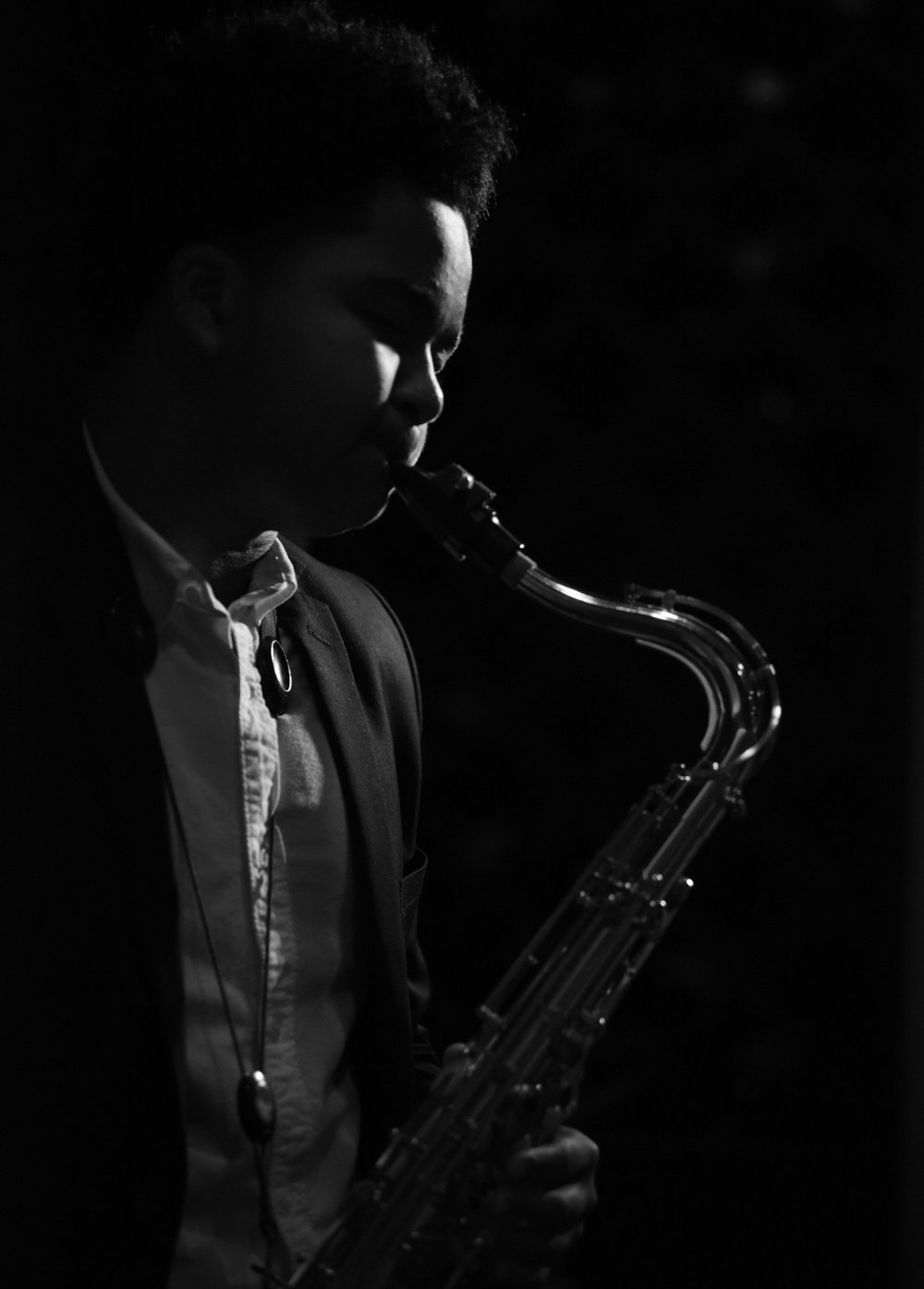 """Winston Bell began playing bass at the age of six while attending Dilworth Elementary School. During the summer of 2011, Winston attended the Duquesne University Music Jumpstart Program where he began playing the alto saxophone. As the spring of 2013 approached, Winston's knowledge and technique had grown well beyond his young age. His robust and soulful tone plays tribute to the jazz greats like John Coltrane, Wayne Shorter and Maceo Parker while cultivating his own, unique sound. """"To me, playing in a band is like being with people that share the same love and interest for music. When you play with them, they understand the language of music and know how to respond in that language. It also gives me a new opportunity to make music."""" -Winston Bell"""