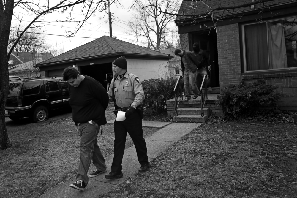 Adam Michilak, left, and Joshua Bennett, right, are led out a South Toledo home by police after Toledo Narcotics and SWAT officers raided the house at 3034 S. Byrne Road on April, 12. Police valued the confiscated materials, including up to 65 hydroponic marijuana plants, seven pounds of processed marijuana, and an SKS assault rife, and a Dodge Charger at an estimated $115,800. Much of the marijuana seized was hydroponically grown, a shift officials say has been impacted by the higher potency marijuana commonly used by medicinal marijuana users in Michigan.