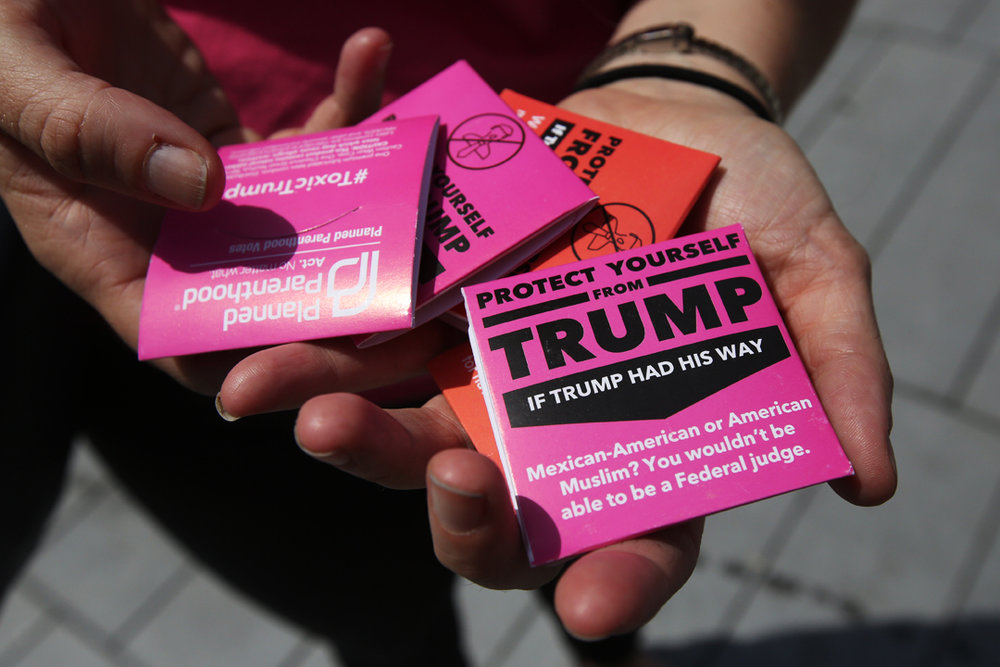 The national office of Planned Parenthood's Action Fund were handing out condoms decorated with anti-Donald Trump messages in Public Square on the third day of the Republican National Convention Wednesday, July 20, 2016, in downtown Cleveland. Among the thousands of people flocking to the attend the convention at the Quicken Loans Arena hundreds of people also turned out to protest and counter protest.