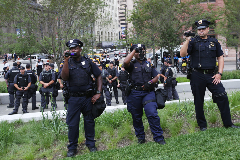 Police officers record a protest during the fourth and final day of the Republican National Convention Thursday, July 21, 2016, in Cleveland. Temperatures soared and Public Square, the source of many protests, was largely quiet.