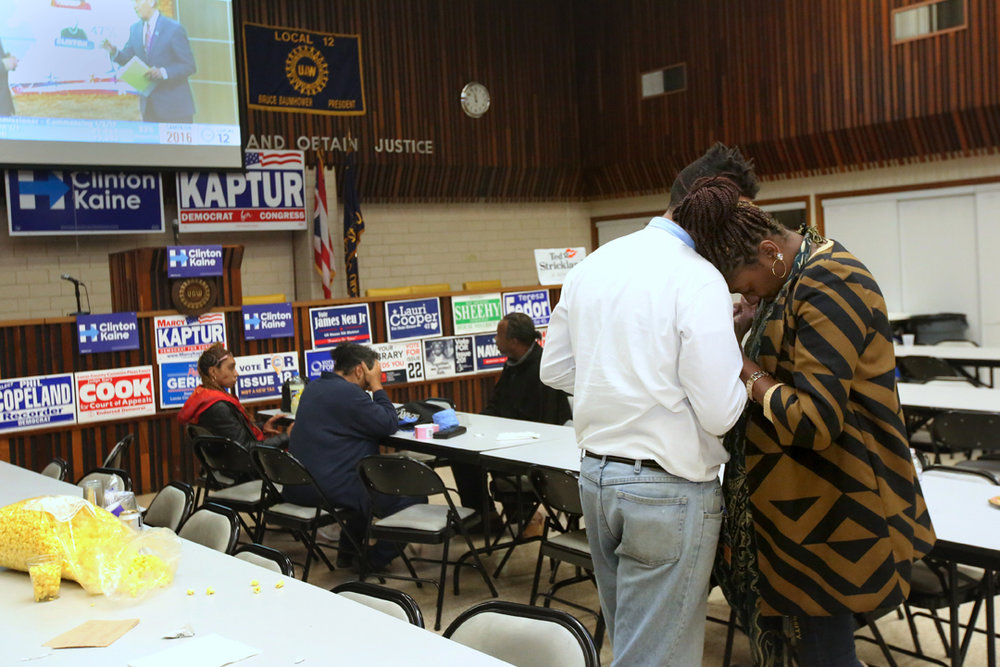 Local activist Julian Mack, center left, comforts Ruth Leonard, right, at a nearly abandoned Election Night watch party Tuesday, November 8, 2016, at the UAW Local 12 Hall in Toledo. Democratic supporters from around Lucas county were gathered to watch the results roll in.