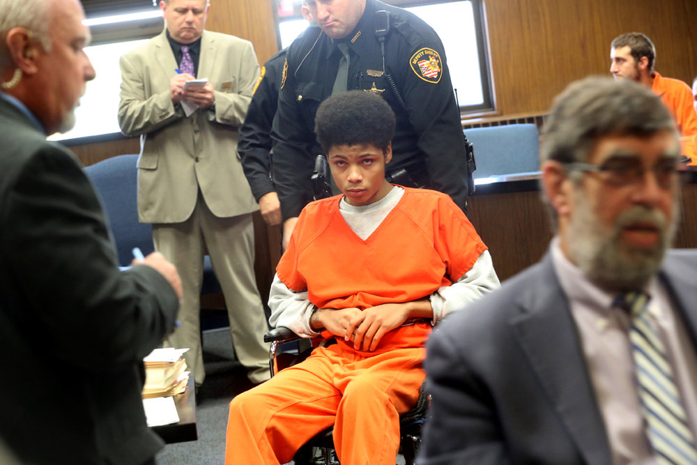Devonte Brown, then 16, is wheeled out of the courtroom after being arranged before Lucas County Common Pleas Judge Ian English Thursday, October 8, 2015, on two counts of aggravated murder, one count of attempted murder, and other charges for stabbing to death his estranged girlfriend and her brother, and injuring their mother Josianne Thomas on August 10, 2015. He was certified to stand trial as an adult and entered an Alford Plea. Judge English found Brown guilty of two counts of aggravated murder for the slayings, sentencing him to life in prison as well as an additional 22 years for the attempted murder of Thomas. Now 17, Brown is currently the only juvenile in Lucas County serving life in prison without the possibility of parole.