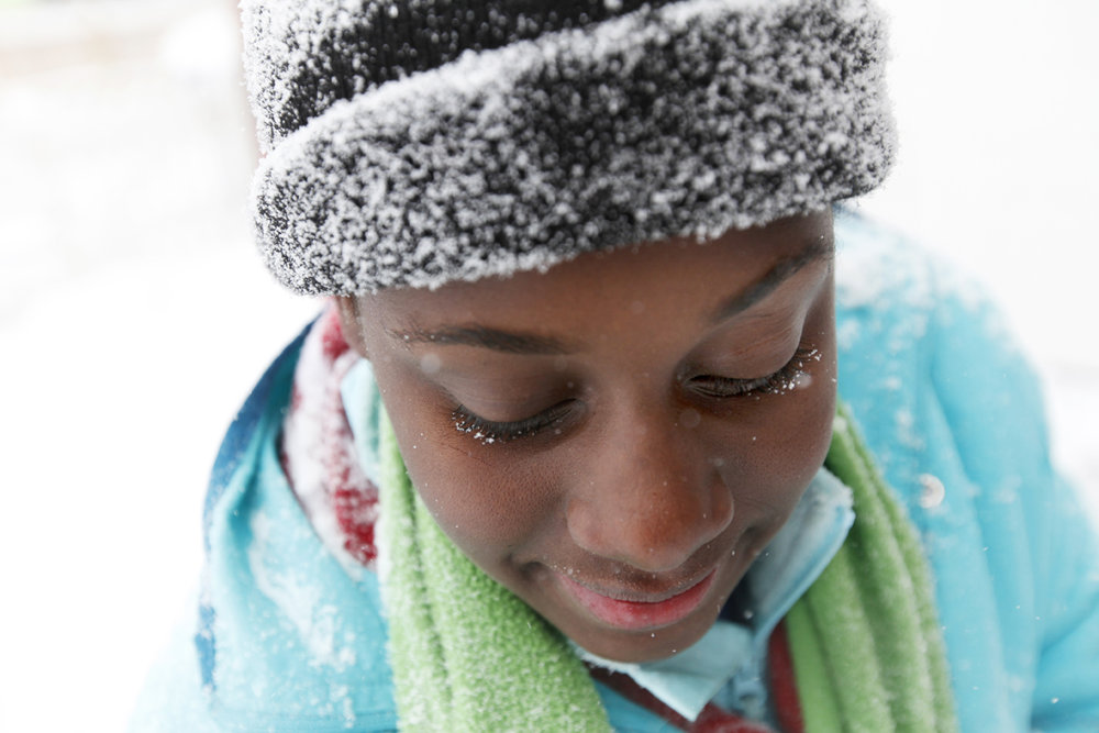 Latara Walker, 12, lends her shovel to the effort to clear the driveway of her cousin's home as falling snow gathers on her eyelids in West Toledo. Snow fall from early Wednesday, Jan. 1, 2014, through 1 p.m. of Thursday, Jan. 2, 2014, totaled 9.1 inches. Snowfall throughout the end of 2013 and beginning of 2014 broke numerous local records.