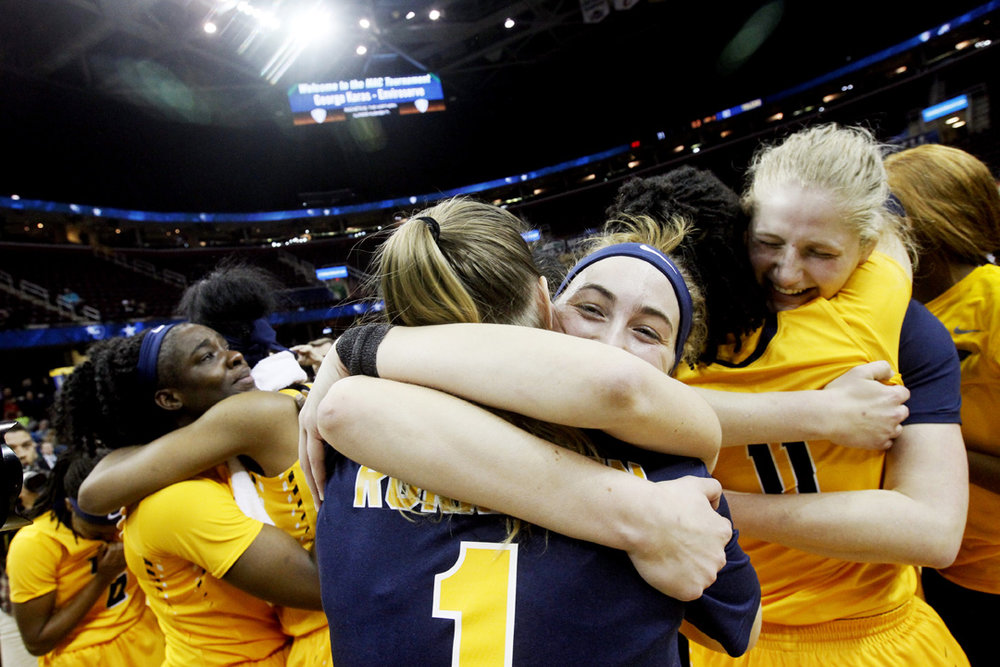 From left: Toledo's Janice Monakana is hugged by Kaayla McIntyre as Mariella Santucci, center, embraces by Sara Rokkanen (1) and Jay-Ann Bravo-Harriott (11) hugs Sophie Reecher, right, after they beat Northern Illinois to win the Saturday, March 11, 2017, MAC Championship at the Quicken Loans Arena in Cleveland. Toledo won, 82-71.