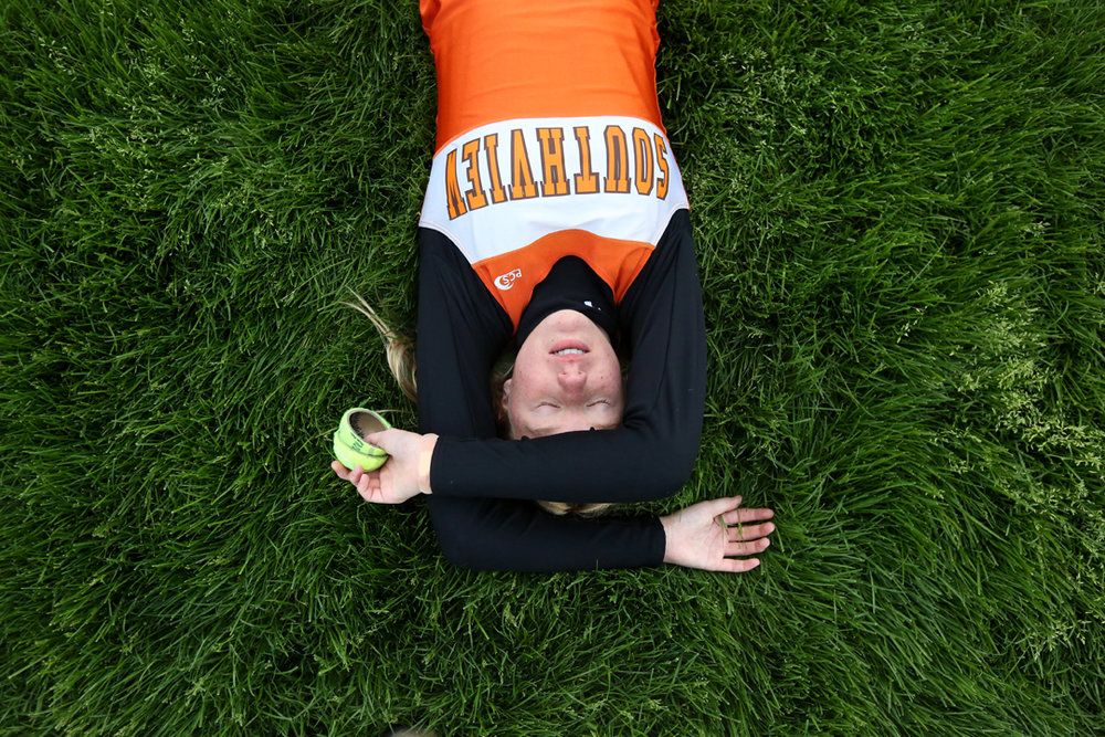 Southview's freshman Helen Waldie catches her breath after running with three other teammates in the 4 by 200 meter relay during the Northern Lakes League track and field championship meet at Maumee High School. Southview's team won the relay.  The tennis ball halves Waldie held are used to mark runner position on the track.