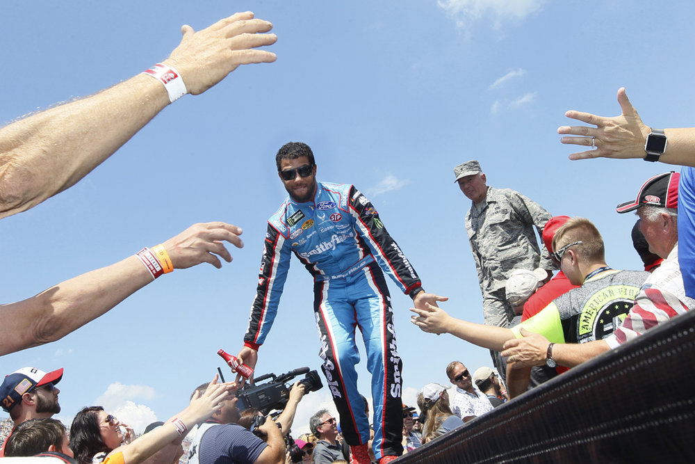 Darrell Wallace, Jr. greets fans during the driver introduction before the 49th Annual FireKeepers Casino 400 race Sunday, June 18, 2017, at Michigan International Speedway in Brooklyn, Mich. Thousands of fans turned out for the first of two NASCAR race weekends.
