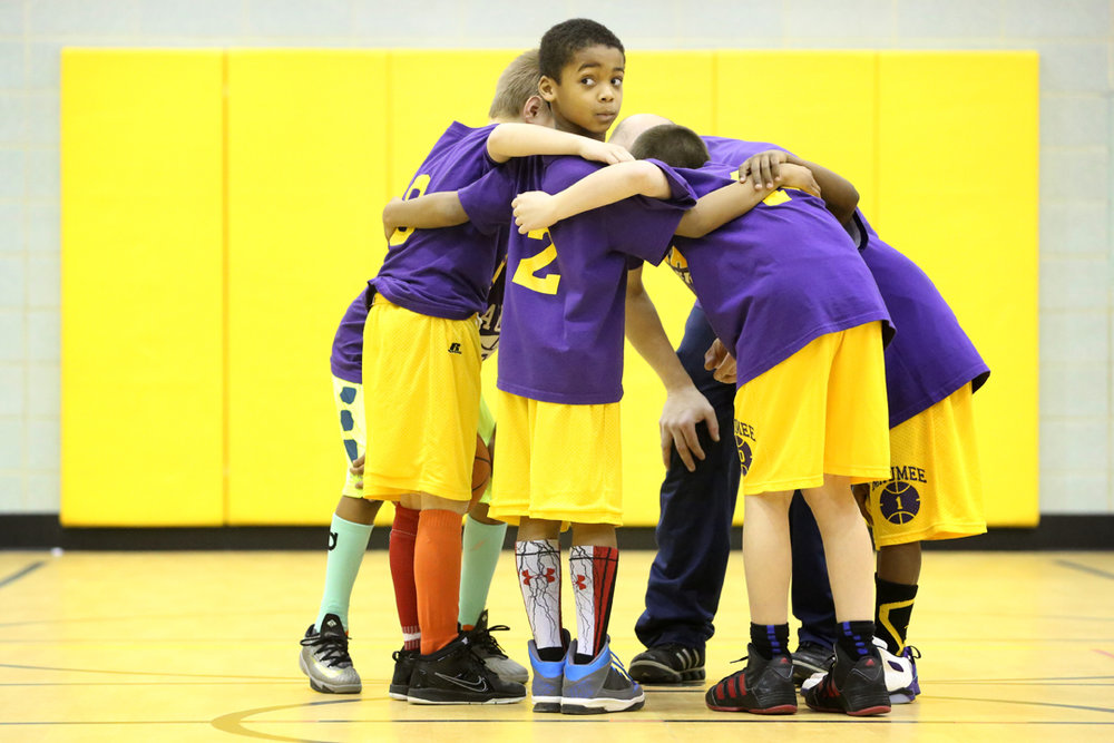 Austin Proctor, 8, center, broke from his group's huddle to look back at his opposing teammates in a scrimmage during basketball team practice at Fairfield Elementary in Maumee. The Panthers have taken to wearing colorful socks to augment their uniforms.