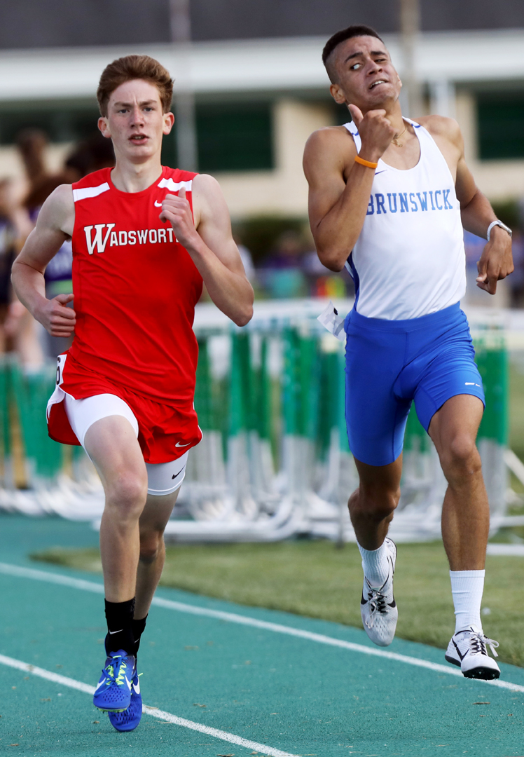 Brunswick's Andre Bollam-Godbot, right, keeps an eye on the Brunswick's Game Szalay in the 1600 Meter Run at the Division I Region II Track and Field Championship meet Friday, May 26, 2017, at Amherst Steele High School.
