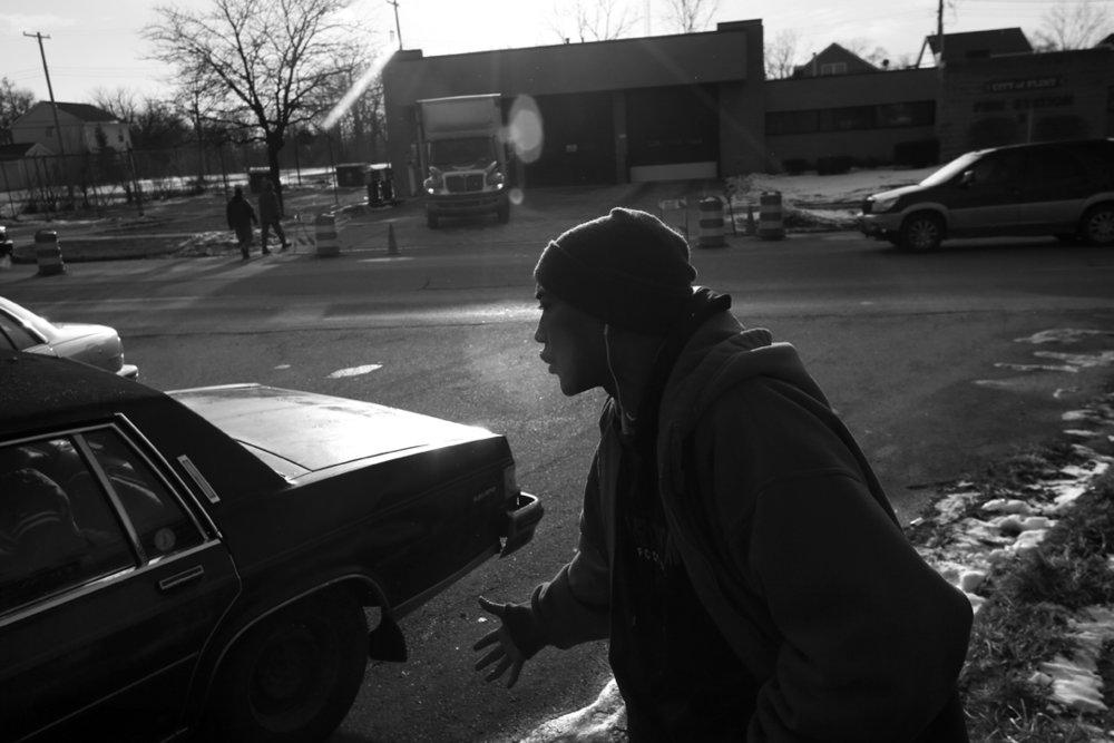 Darryl Matiere Sr., an Air Force and Air National Guard veteran, emphatically denounces Michigan's Governor Rick Snyder to fellow Flint resident Audrea Crawford (not pictured) after both came to one of the city's fire stations to pick up a case of bottled water Wednesday, January 20, 2016, in Flint, Michigan. The pair said they felt no one had been held accountable for the mass lead poisoning.
