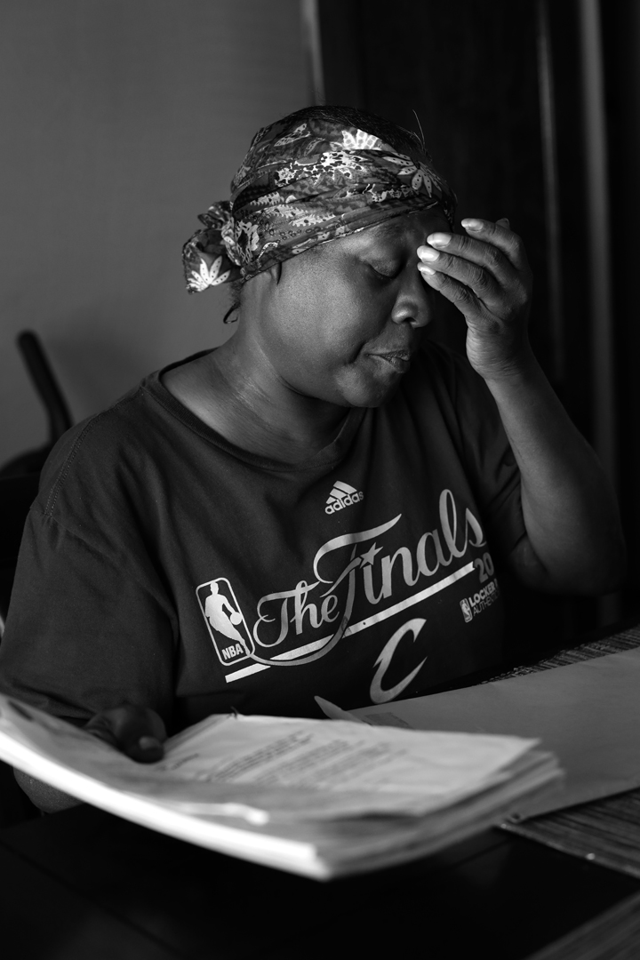Velma Rollins has kept records of her struggle with the Cuyahoga County Board of Health. She has lived in her house off and on since she was a small child and has raised children and grandchildren there. Now, her son owns the property and the pair have struggled to sort out the Board of Health's ordered lead abatement, which was triggered after Ms. Rollins' grandson tested positive for elevated levels of lead. Their house was one of nearly 90 in Cuyahoga County for whom the Board of Health has issued Orders of Eviction after noncompliance with lead abatement. Low-income owners often struggle to pay for the ordered abatement.