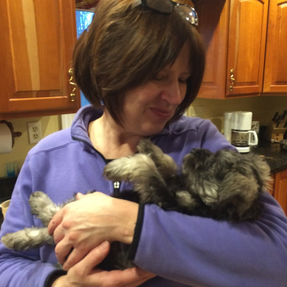 Here is my mom with our adorable tiny puppy.