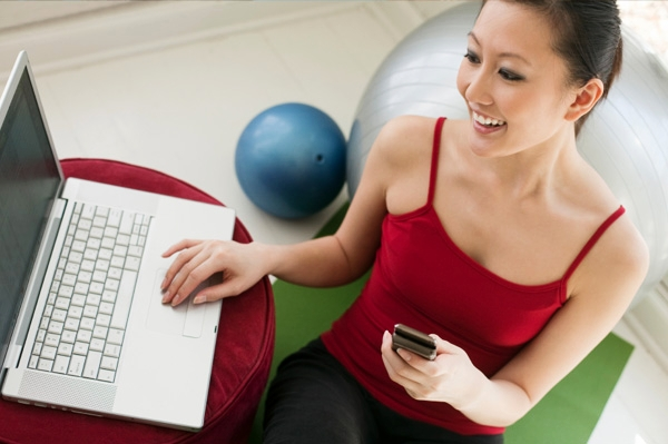 woman-exercising-near-computer.jpg