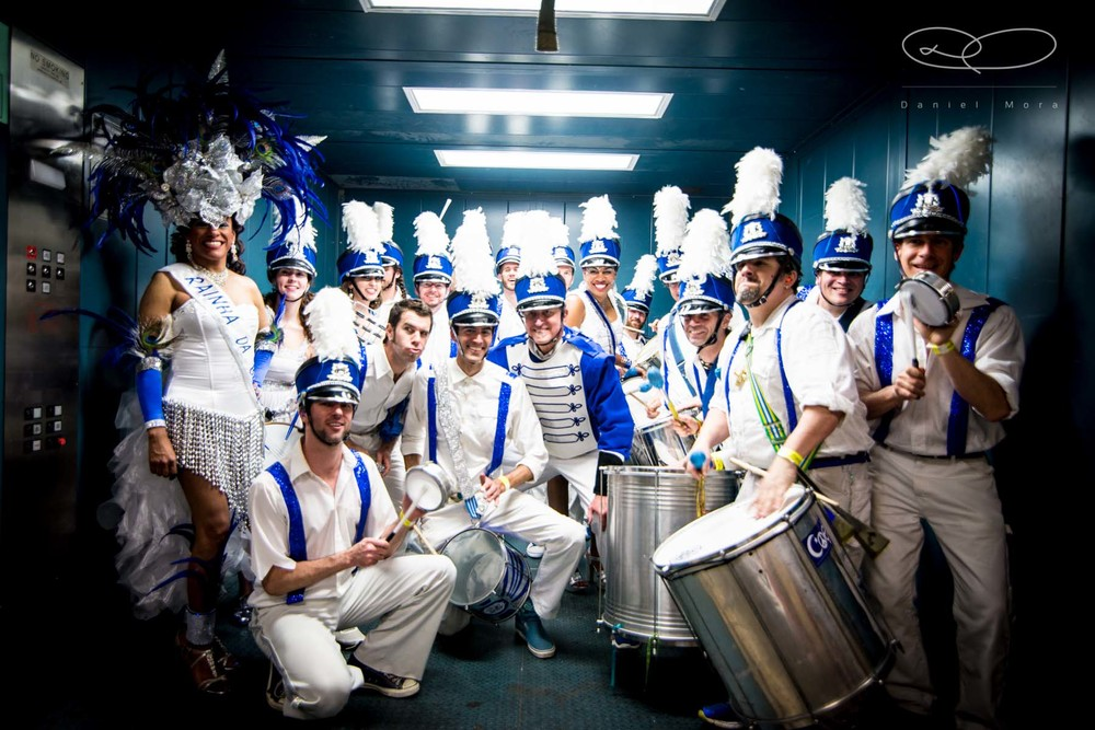 "Part of the Austin Samba bateria in costumes for ""Orfeu."""