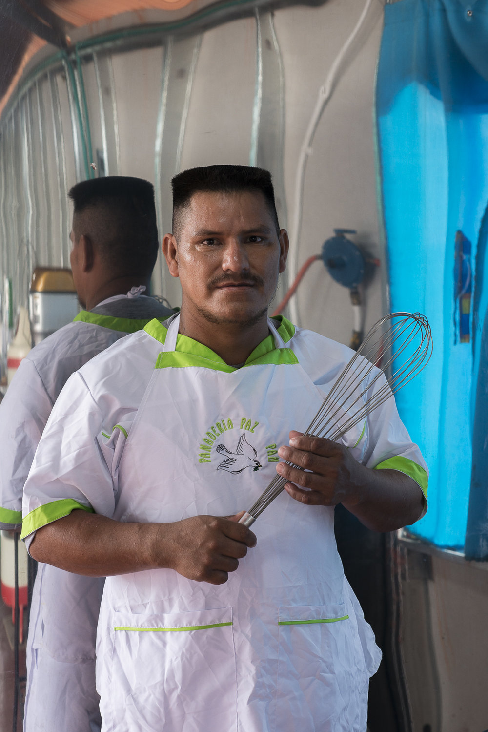 "Eduardo, 32th Front, is one of the baker of ""Paz y Pan"", peace and bread, the bakery of El Carmelita transitional zone."