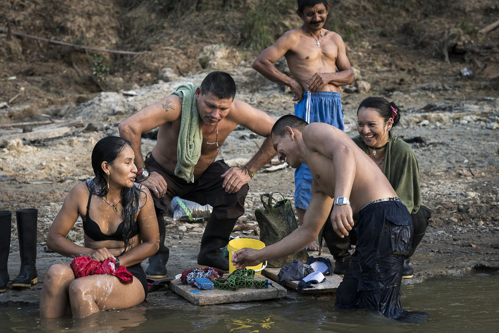 A group of guerillleros is bathing and laundying their clothes at the end of the day. The dalylife into the guerrilla is a community life.  Most of the time the guerrilleros share every moment.(January 24, 2016. Putumayo)