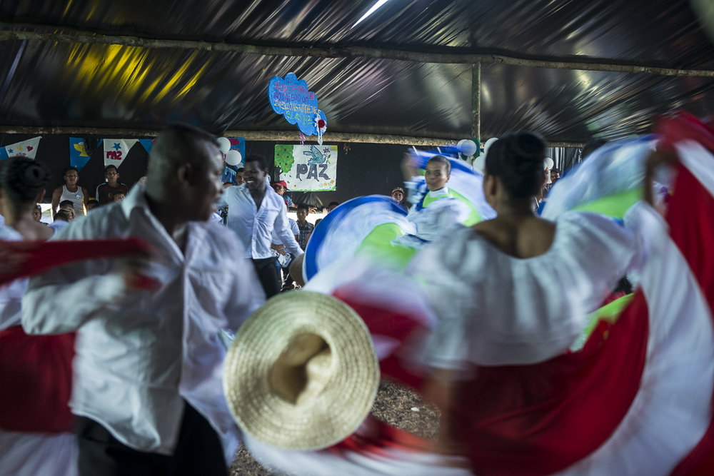 "Cultural dancing at the ""Vigil for Peace"", called by the FARC commanders to support the peace process after the negative voting result of the national referendum. The civilians and the social and religious organizations were invited to join the FARC-EP camp a night to invoke a peaceful future. (October 31, 2016, Putumayo)"