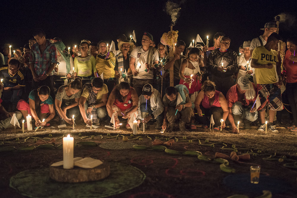 "Civilians and guerrilleros file some candles at the time of  the ""vigil  for peace"" called by the FARC commanders to support the peace process after the negative voting result of the national referendum. The civilians and the social and religious organizations are invited to join the camp a night to invoke a peaceful future. (October 31, 2016. Putumayo"