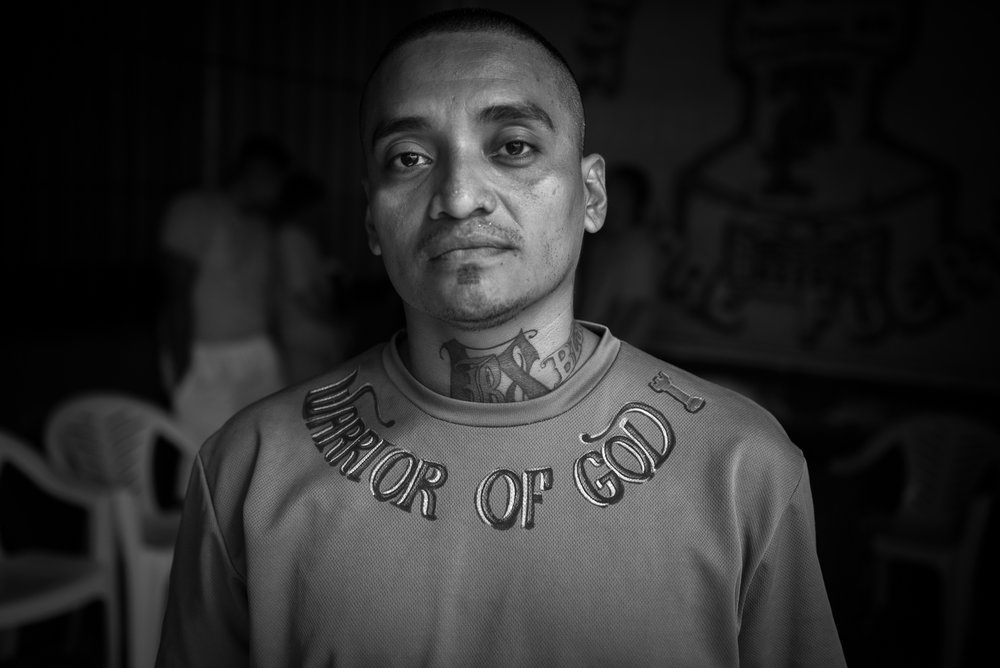 "The assistant of the general pastor wears a sweat-shirt with the writing ""Warrior of God"". The inmates and former gang members, consider themselfves as an army of God."