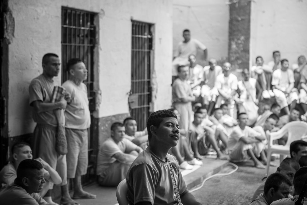 The inmates are listening the pastor talking at the time of the worship in the 1,2,3 yards of La Gotera's jail.