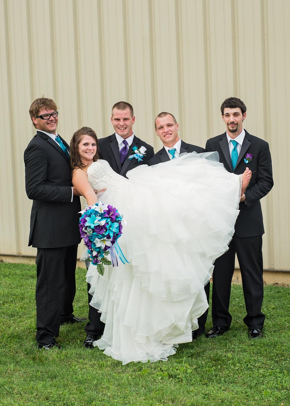 groomsmen-holding-bride