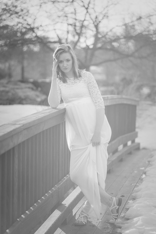 bride-holding-dress-outside
