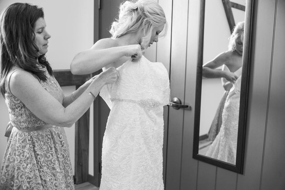 bride-getting-dress-on