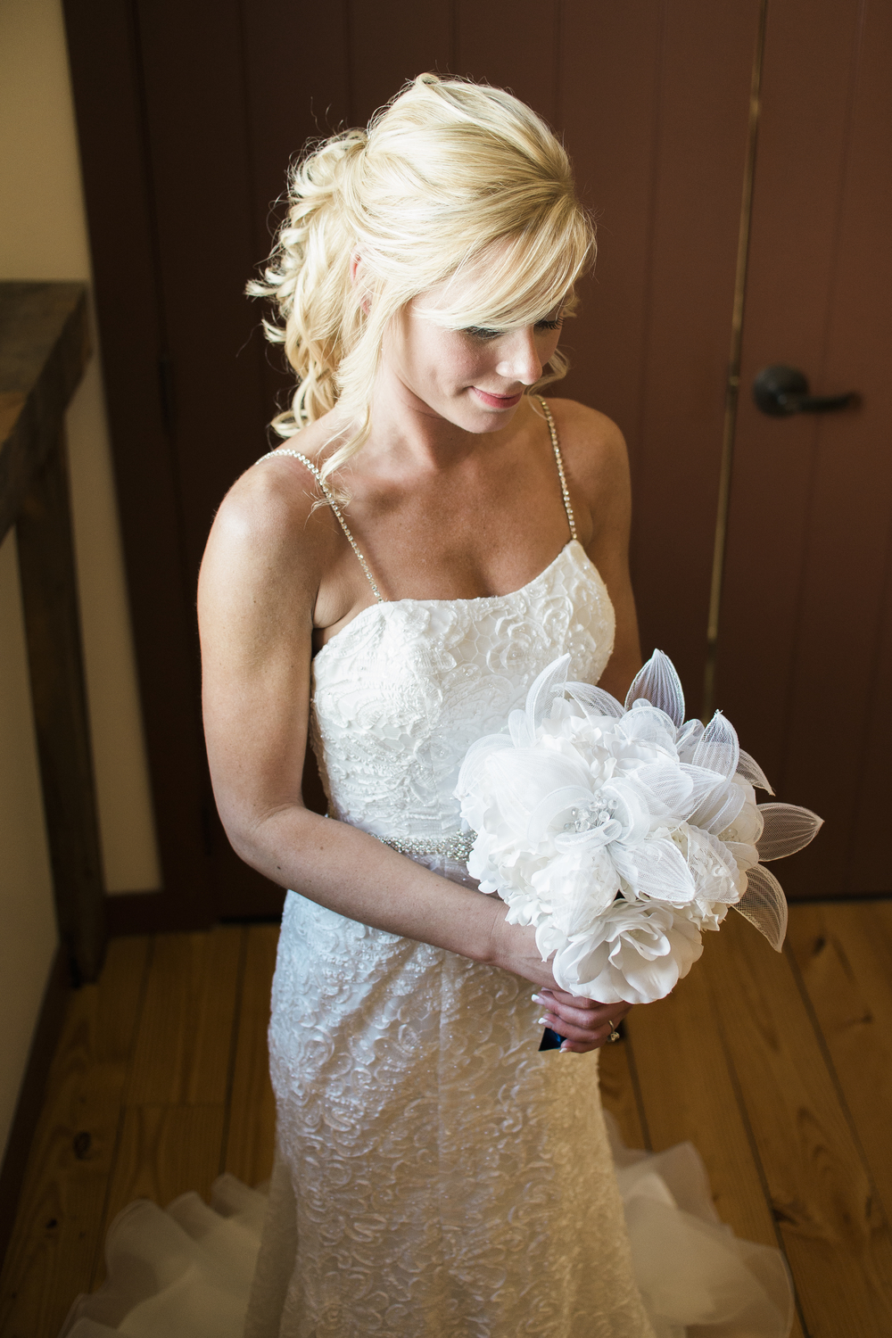 bride-poses-with-bouquet