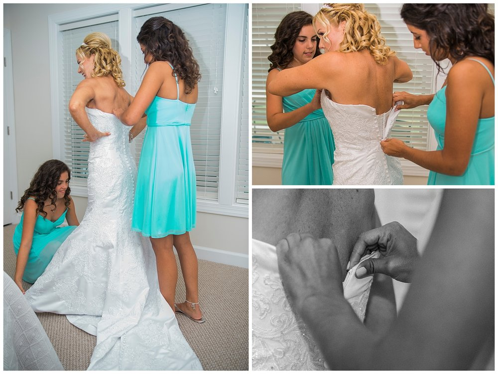 bride-getting-dressed-wedding-photographer-lancaster.jpg