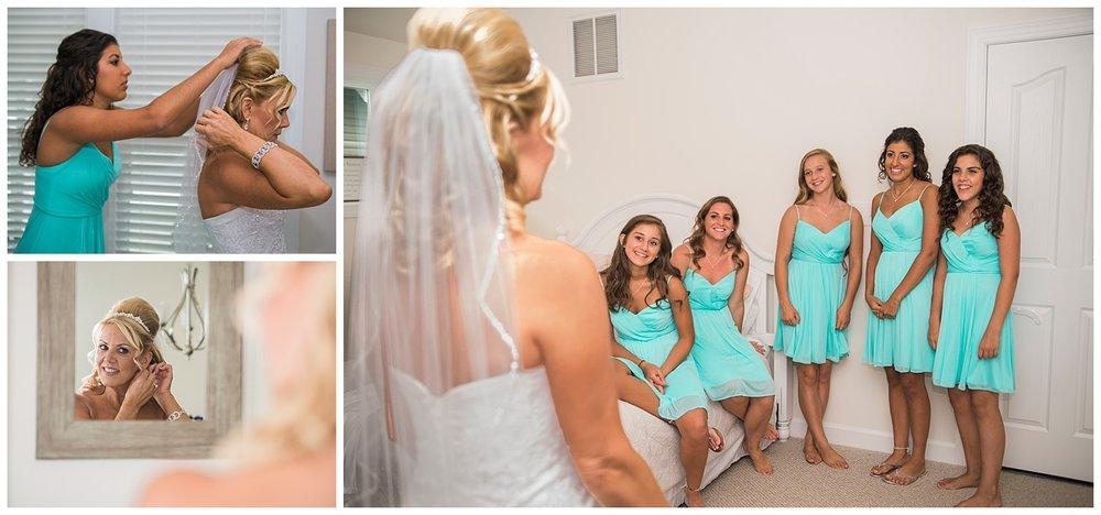 bridesmaids-seeing-bride-wedding-photographer-rehobeth.jpg