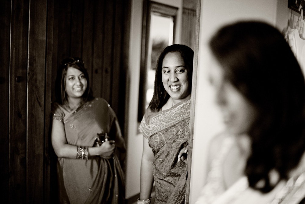Bride's friends watching her get ready