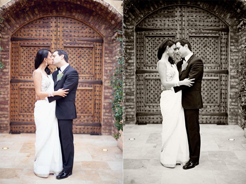 Meera and Jorge wedding pictures in front of wooden door at Sassi