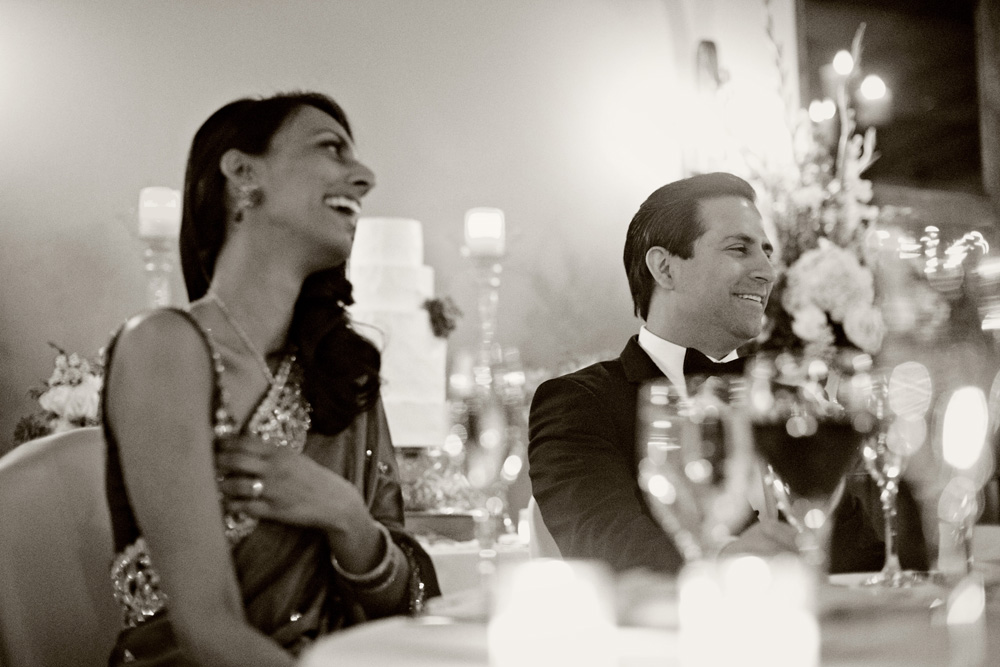 Meera and Jorge laugh at wedding speeches
