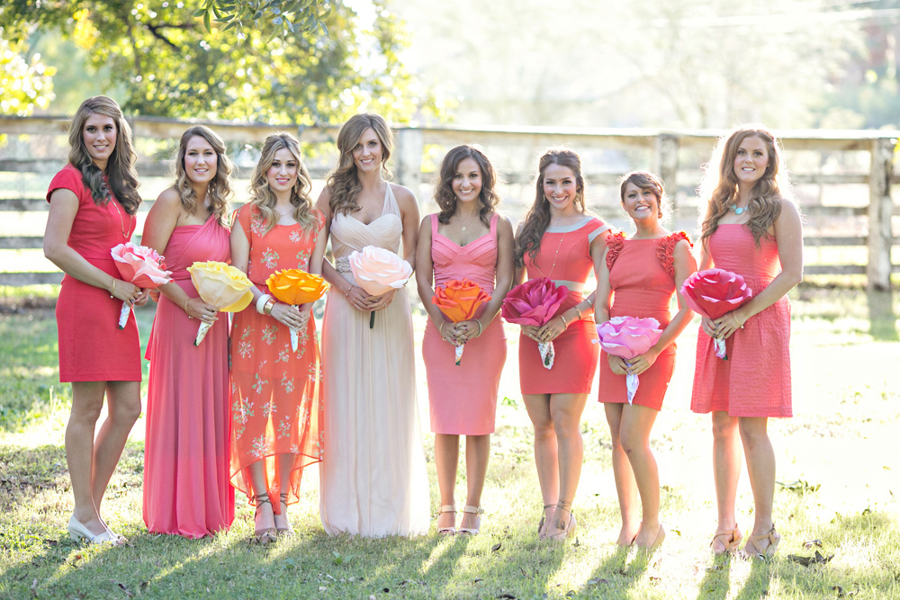 Shelby and her bridesmaids with pink dresses and paper flowers at The Farm at South Mountain