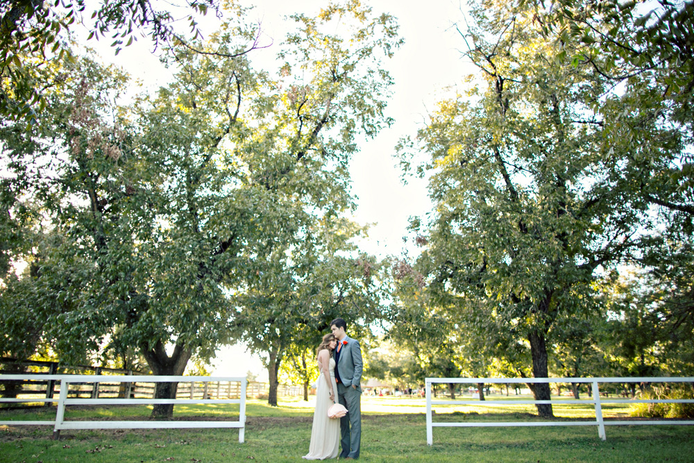 Zack and Shelby take photos between the beautiful trees at The Farm at South Mountain