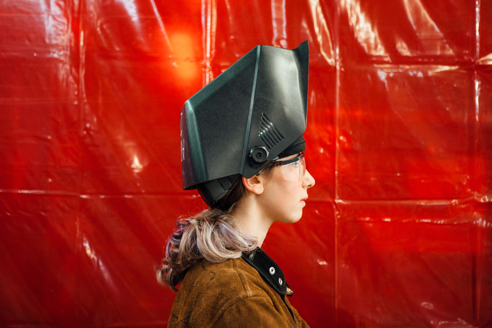 Elle Aiken, 16, in her ARC Welding gear. Aiken attends a summer class for children to learn how to weld at The Crucible, an arts education foundry in Oakland.