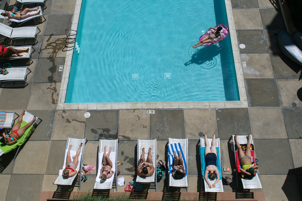 Residents from The Uptown apartment complex in downtown Oakland relax by the pool during a heat wave on April 22, 2013.