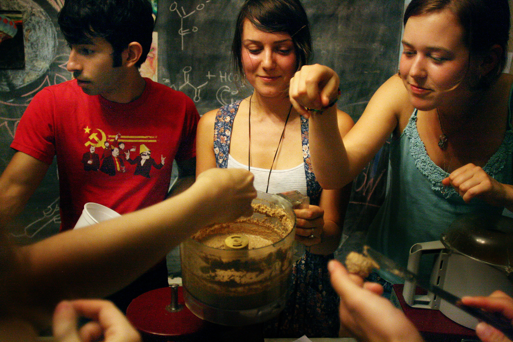 Anna Bee, center, teaches students at Andres Castro Arm Co-operative how to make homemade nut butter. She started her own business selling nut butters by bicycle.